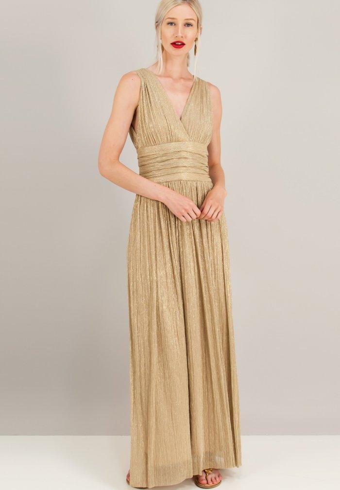 e9f2ed473f00 Σε ένα αρχαιοελληνικό φόρεμα σίγουρα ταιριάζουν lux flat σανδάλια ή ένα  ζευγάρι απλά nude πέδιλα. Σε κοσμήματα προσθέσεις ή ένα ζευγάρι σκουλαρίκια  ...